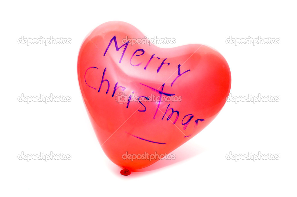 Merry christmas written in a heart-shaped balloon  Stock Photo #4287554