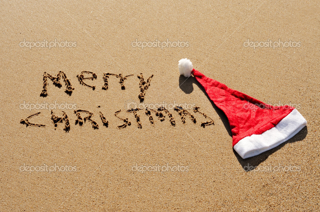 Sentence merry christmas written in the sand — Stock Photo #4321506