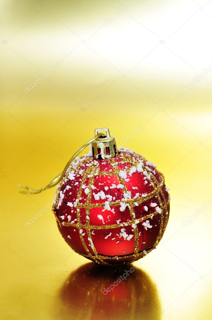 Red and golden christmas ball on a golden background  — Stock Photo #4361515