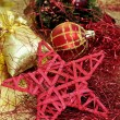 Red and golden christmas ball and other christmas ornaments - Stockfoto