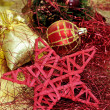 Red and golden christmas ball and other christmas ornaments — Stock Photo