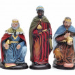 Figures representing the three kings in a nativity scene on white b - Stock Photo