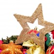 Some christmas stars and balls on a white background — Stock Photo