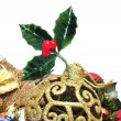 Stock Photo: Golden christmas ball and other christmas ornaments on white background