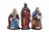 Figures representing the three kings in a nativity scene on white b — Stock Photo