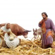 Figures representing nativity scene on white background - Stock Photo
