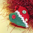 A christmas ornament and red tinsel on a golden background — Stock Photo #4473445