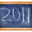 Stock Photo: 2011 written with chalk in a blackboard