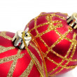 Red and golden christmas balls on a white background - Stock Photo