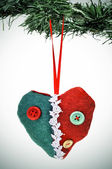 A christmas ornament hanging on a christmas tree — Stock Photo