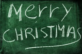 Merry christmas written with chalk on a blackboard — Stock Photo