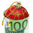 A christmas ball with euro bills symbolizing consumerism — Stock Photo