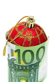 A christmas ball with euro bills symbolizing consumerism — Stockfoto