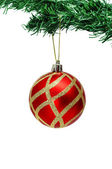 A red and golden christmas ball hanging on a christmas tree — Stock Photo