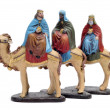 Figures representing the three kings in a nativity scene on white backgroun — Stock Photo