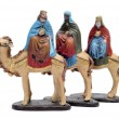 Figures representing the three kings in a nativity scene on white backgroun - Stock Photo
