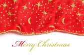 Merry christmas written in a background with a christmas patterned fabric — Stock Photo