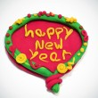 Happy new year written in design made with modelling clay — Stock Photo #4534888