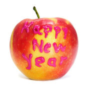 Happy new year written in an apple — Stok fotoğraf