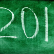 Stock Photo: 2011 written with chalk on a blackboard