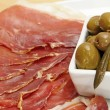 Serrano ham and olives — Stock Photo