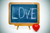 "Word ""love"" written in a blackboard — Stockfoto"