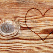 Heart on a wood board — Stock Photo