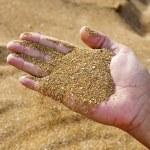 zand in de hand — Stockfoto