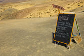 Blackboard menu of a spanish beach bar — Stock Photo