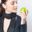 Stock Photo: Beautiful young womholding green apple