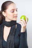Beautiful young woman holding green apple — Stock Photo