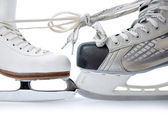 Ice skates tied against each other — Stock Photo
