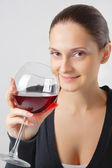 Beautiful young lady with a glass of wine — Stock Photo