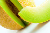 Melon honeydew and melon slice — Stock Photo