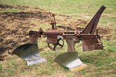 Old plow for tractor — Stock Photo