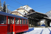 Red train on mountain — Stock Photo