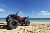 Quad on the beach — Stock Photo