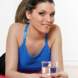 Sport and glass of water — Stock Photo