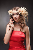 Beautiful brunette young wooman in ethnic hat holding hand near — Stock Photo