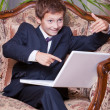 Happy business boy sitting pointing in computer screen proposing — Stock Photo #5010548
