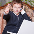 Young smiling businessman with computer showing ok — Stock Photo #5010662
