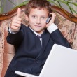 Young smiling businessman with computer showing ok — Stock Photo