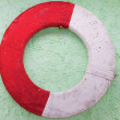 Old lifebuoy on a wall - Stock Photo