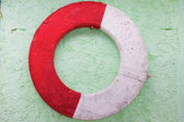 Old lifebuoy on a wall — Stock Photo