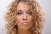 Serious curly women — Stock Photo