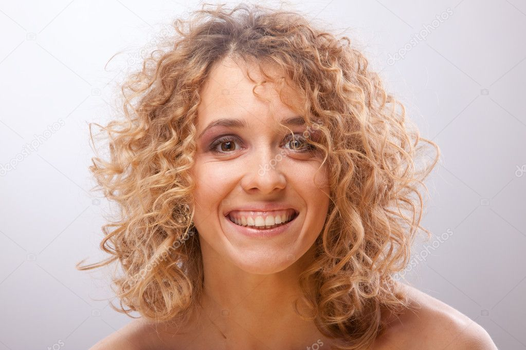 Smiling women with curly hair — Stock Photo #5185310