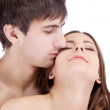 Sensual kissing dreaming couple of young lovers — Stock Photo