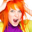 Shocked screaming woman holding red head with hands - Stock Photo