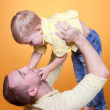 Happy young father playing with his son — Stock Photo