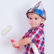 Little cute boy on ladder painting wall with roller — Stock Photo #5250506